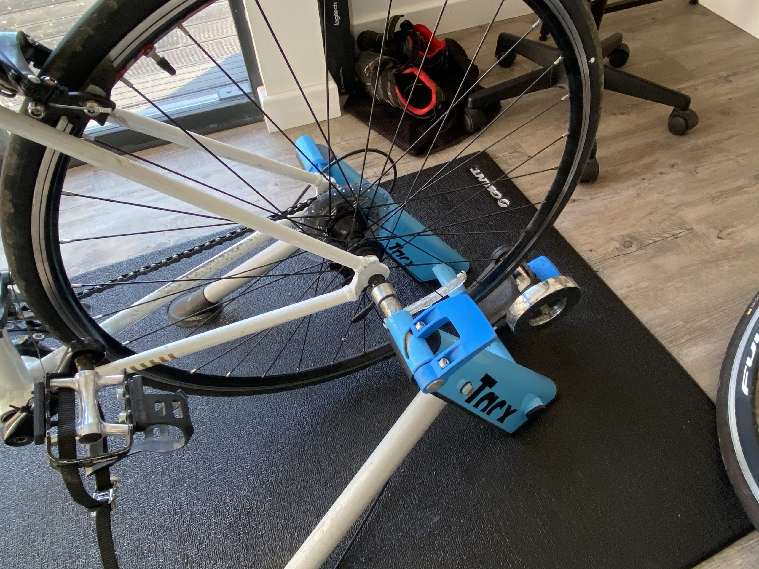 Basic resistance wheel trainer, bike clamped in place